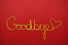 Goodbye ribbon greeting and hearts on red background Stock Images