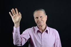 Goodbye. Senior waving goodbye showing his palm Royalty Free Stock Photos
