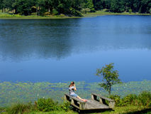 Goodbye to summer. Picture of the girl near the lake at the end of summer Royalty Free Stock Photography