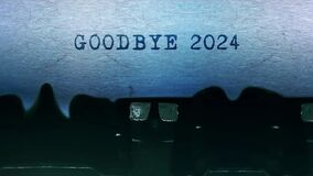 Goodbye 2024 words Typing on a sheet of paper with an old vintage typewriter.