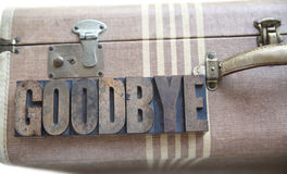 Goodbye word on vintage suitcase Stock Photo