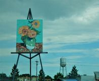 Worlds Largest Easel Goodland Kansas. Goodland Kansas is home to the worlds largest Easel featuring a painting of sunflowers royalty free stock photography