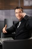 Goodlooking businessman chatting on phone Royalty Free Stock Images