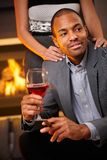 Goodlooking man with cigar and glass of wine Stock Photography