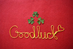 Goodluck ribbon greeting and hearts on red background Stock Images