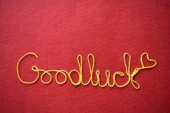 Goodluck serca na czerwonym tle i Obrazy Stock