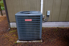 Goodman HVAC Unit on House Stock Photography