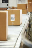 Goods On Conveyor Belt In Distribution Warehouse. Ready To Be Shipped stock photography