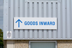 Goods Inward sign on industrial building Royalty Free Stock Image