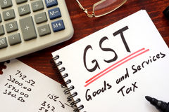 The goods and services tax  GST. The goods and services tax  GST written in a note Stock Photo