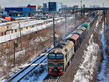 Goods train carries cargo on railway track. Stock Image