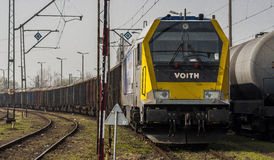 Goods train in Station. Szczecin, Poland - March 31, 2014: Goods train at the station Szczecin Gumience.Lokomotive brand Voith Maxima 40CC Royalty Free Stock Image