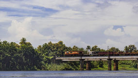 Goods train under clouds. Indian railway - Goods train passing through bridge over Periyar river in Kerala Royalty Free Stock Photography