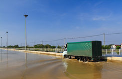 Goods truck on flooded road Stock Images