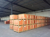 Goods in the warehouse. Wooden boxes filled with goods in the warehouse Stock Images