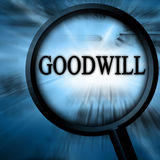 Goodwill. On a blue background with a magnifier Royalty Free Stock Photo