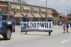 Goodwill Banner in parade in small town America Stock Images