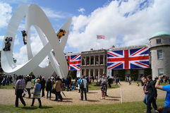 Goodwood House. 30th June 2012 at Goodwood Festival of Speed, West Sussex, England. Goodwood House home to Lord March  with Union flags and Lotus Sculpture in Stock Photo