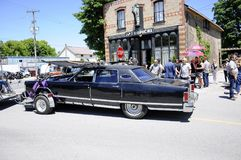 On location filming featuring `Johnny`s Car` near Cafe Tropical a fictional restaurant featured in Schitt`s Creek. Goodwood, Ontario, Canada, June 11, 2018: On royalty free stock image