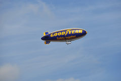 Goodyear blimp. LONDON - SEPTEMBER 03: A Goodyear blimp flying over London, on September 03, 2011 in London. Goodyear is one of the main tire manufacturer in the stock image