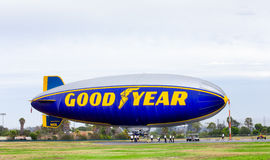 The Goodyear Blimp. CARSON, CA/USA - AUGUST 2, 2014: The Goodyear blimp. The Goodyear blimp is any one of a fleet of blimps operated by Goodyear Tire and Rubber stock photography