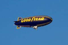 Goodyear blimp. The Goodyear blimp flying over the Tournament of Roses Parade stock image