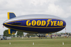 Goodyear Blimp readying for flight. OSHKOSH, WI - JULY 27: The Good Year blimp Zeppelin, Spirit of Goodyear (with the distinctive yellow stripe), gets ready to royalty free stock photography