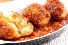 Gooey macaroni cheese balls with marinara sauce Royalty Free Stock Image
