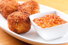 Gooey macaroni, cheese balls with marinara sauce Royalty Free Stock Photography