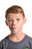 Goof Face. Boy making a silly face white background Royalty Free Stock Photo