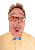Goofy Bowtie Man. A very happy funny man in a yellow shirt and a tiny blue bowtie Royalty Free Stock Photo