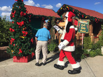 Goofy Claus. Goofy dressed as Santa Claus gets ready to greet fans at Disney Springs, Orlando, FL Stock Photo
