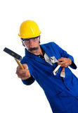 Goofy Construction Worker Showing his Tools. A goofy-looking construction worker in a yellow hardhat, protective goggles and blue jumpsuit, showing his tools. He Stock Images