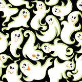 Goofy Ghosts Seamless Pattern. Spooky Wiggly Ghost Pattern on Black Stock Photo