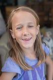 Goofy girl smiling to camera Stock Image