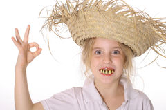 Goofy girl in straw hat ok. Isolated on a white background Stock Images