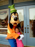 Goofy. Hong Kong, Circa September 2010. Pretty girl posing with Disney's Goofy at the Hong Kong Disney resort Royalty Free Stock Photos