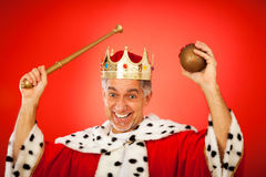 Goofy King. Senior man in king`s dress, making faces Royalty Free Stock Photography