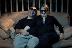 Goofy Nerd couple watching 3D TV Royalty Free Stock Photography