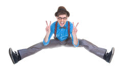 Goofy, nerd geek jumping with v sign. Goofy, nerd geek jumping and shouting with v sign Stock Photography