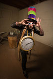 Goofy Poser with Large Clock Stock Image