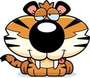 Goofy Saber-Toothed Tiger. A cartoon illustration of a saber-toothed tiger cub with a goofy expression Stock Photos