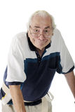 Goofy Senior Man. Half-length image of an elderly man with a goofy expression, wearing a gait belt and leaning over his walker (out of view).  On a white Stock Image