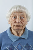 Goofy senior woman. Head and shoulders portrait Stock Images