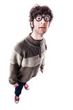Goofy student. An handsome guy, maybe a student, in casual clothing with thick glasses and a nerdy look. isolated on white Royalty Free Stock Images