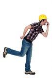 Goofy tradesman holding an object Stock Photo