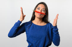 Goofy woman with a chili pepper mustache stock photo