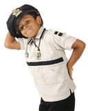 Goofy Young Policeman. An adorable preschooler displaying his policeman's hat and whistle. Isolated stock photos