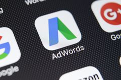 Google Adwords application icon on Apple iPhone X screen close-up. Google Ad Words icon. Google adwords application. Social media. Sankt-Petersburg, Russia Stock Photos