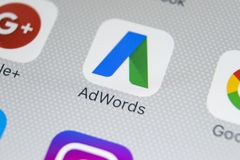Google Adwords application icon on Apple iPhone X screen close-up. Google Ad Words icon. Google adwords application. Social media. Sankt-Petersburg, Russia Stock Photo